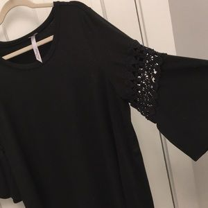 Black asymmetrical top with bell sleeves